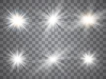 Light glow effect stars. Vector sparkles on transparent background. Christmas abstract pattern. Sparkling magic dust particles. stock illustration