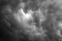 Light of God shining through black clouds Stock Photos