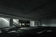 Light goes stairs down at underground car park. At night Royalty Free Stock Photography
