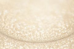 Light gold yellow glitter background. royalty free stock photography