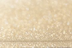 Light gold yellow glitter background. royalty free stock photo