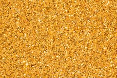 Light golden background with brilliance perfect for Christmas, New Year or any other Holidays. High resolution photo stock photography