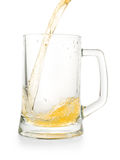 Light golden beer pouring into empty glass pint. Isolated on white, clipping path included stock photos