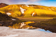 Light golden dawn illuminates the mountains and glaciers Stock Photo