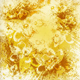 Light golden watercolor brush strokes. With floral ornamental background Stock Image