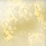 Light golden watercolor brush strokes with floral ornamental. Background Royalty Free Stock Photo