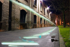 Light graffiti. Light strips on the wall and the street - graffiti of light in the city Stock Images
