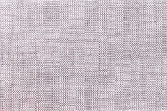 Light gray background of dense woven bagging fabric, closeup. Structure of the textile macro. Stock Images