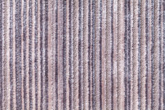 Light gray background of a knitted textile material. Fabric with a striped texture closeup. Royalty Free Stock Image