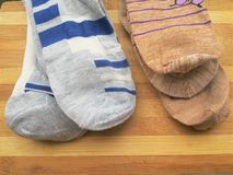 Light gray and dark goldenrod colored men socks Stock Photos