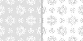 Light gray floral backgrounds. Set of seamless patterns Stock Photography
