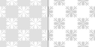 Light gray floral backgrounds. Set of seamless patterns Royalty Free Stock Photos