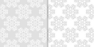 Light gray floral backgrounds. Set of seamless patterns. For textile and wallpapers Royalty Free Stock Photography