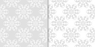 Light gray floral backgrounds. Set of seamless patterns. For textile and wallpapers Royalty Free Stock Images