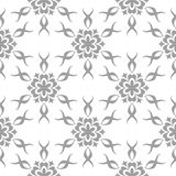 Gray floral pattern on white. Seamless background. Light gray floral ornament on white. Seamless pattern for textile and wallpapers Royalty Free Stock Photo