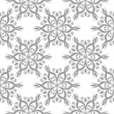 Gray floral pattern on white. Seamless background. Light gray floral ornament on white. Seamless pattern for textile and wallpapers Stock Image