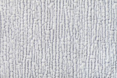 Light gray fluffy background of soft, fleecy cloth. Texture of textile closeup. Stock Photography