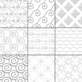Light gray geometric ornaments. Collection of seamless patterns. Light gray geometric ornaments. Collection of neutral seamless patterns for web, textile and Stock Photo
