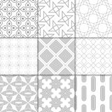 Light gray geometric ornaments. Collection of seamless patterns. Light gray geometric ornaments. Collection of neutral seamless patterns for web, textile and Royalty Free Stock Image