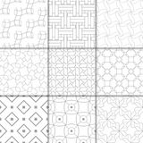 Light gray geometric ornaments. Collection of seamless patterns. Light gray geometric ornaments. Collection of neutral seamless patterns for web, textile and Royalty Free Stock Photography