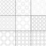 Light gray geometric ornaments. Collection of seamless patterns. Light gray geometric ornaments. Collection of neutral seamless patterns for web, textile and Royalty Free Stock Images
