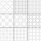 Light gray geometric ornaments. Collection of seamless patterns. Light gray geometric ornaments. Collection of neutral seamless patterns for web, textile and Stock Photography