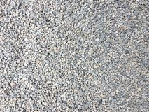 Light gray granite gravel floor texture background. Top view of rough surface street royalty free stock photo