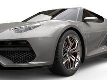 Light gray metallic super sports car - front wheel closeup Royalty Free Stock Image