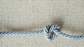 Light gray Rope tie a heart shape Stock Photo