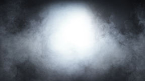 Light gray smoke on a black background. Halloween concept image Royalty Free Stock Photography