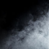 Light gray smoke on a black background. Halloween concept image Stock Photography