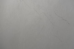 Light gray texture of old wall with cracks Royalty Free Stock Image