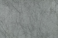 Light gray wavy background from a textile material. Fabric with natural texture closeup. Upholstery fabric pleated stock photography