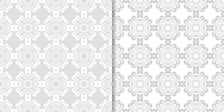 Light gray and white floral seamless ornaments. Light gray and white floral ornaments. Set of seamless patterns for textile and wallpapers Royalty Free Stock Image