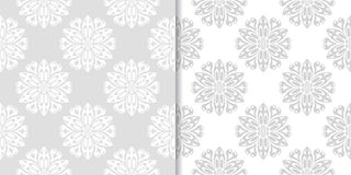Light gray and white floral seamless ornaments. Light gray and white floral ornaments. Set of seamless patterns for textile and wallpapers Royalty Free Stock Images