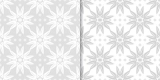 Light gray and white floral seamless ornaments. Light gray and white floral ornaments. Set of seamless patterns for textile and wallpapers Royalty Free Stock Photos