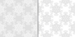 Light gray and white floral seamless ornaments. Light gray and white floral ornaments. Set of seamless patterns for textile and wallpapers Stock Images