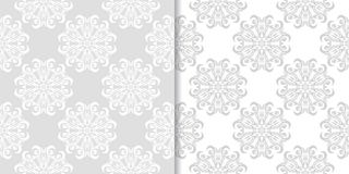 Light gray and white floral seamless ornaments. Light gray and white floral ornaments. Set of seamless patterns for textile and wallpapers Stock Image