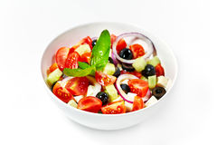 Light greek salad with fresh vegetables, garnished with basil. W Royalty Free Stock Image