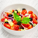 Light greek salad with fresh vegetables, garnished with basil. Royalty Free Stock Photography