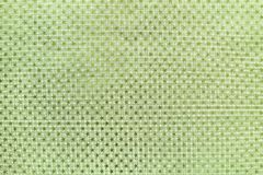 Light green background from metal foil paper with a stars pattern royalty free stock photo