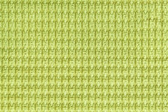 Light green background from soft fleecy fabric close up. Texture of textiles macro stock photo