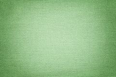 Light green background from a textile material. Fabric with natural texture. Backdrop. Light green background from a textile material with wicker pattern royalty free stock image