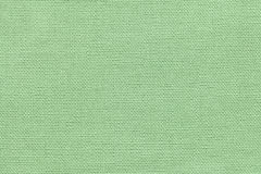 Light green background from a textile material with wicker pattern, closeup. royalty free stock photography