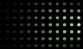Light green balls on a black background. Abstract image. Stock Photo