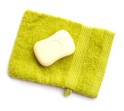 Light green bath glove and a bar of soap Stock Photos