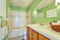 Light green bathroom interior with white tile trim Royalty Free Stock Photos