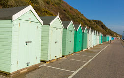 Light green beach huts in a row with blue sky Stock Images