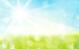 Light green, blue spring background with sun shine and blurry li Royalty Free Stock Image