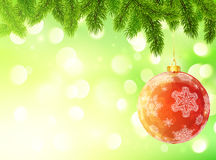 Light green blurred bokeh background with red Christmas ornament ball Royalty Free Stock Image